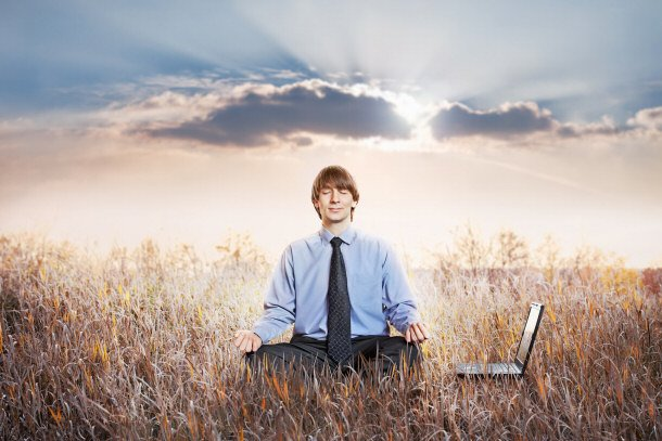 Businessman-Meditating-In-Lotu
